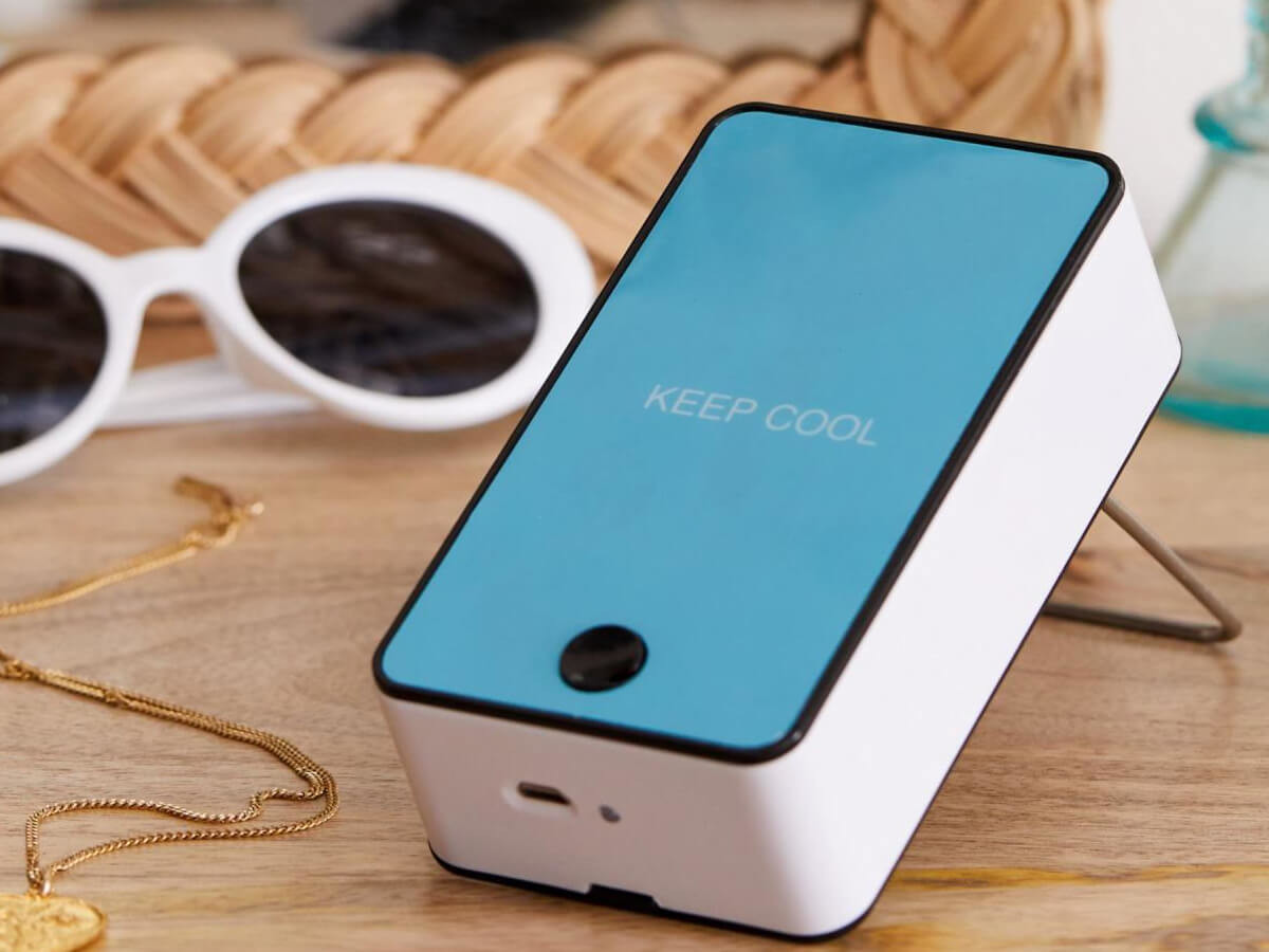 Urban Outfitters Portable Air Cooler Mini Fan keeps you cool at your desk