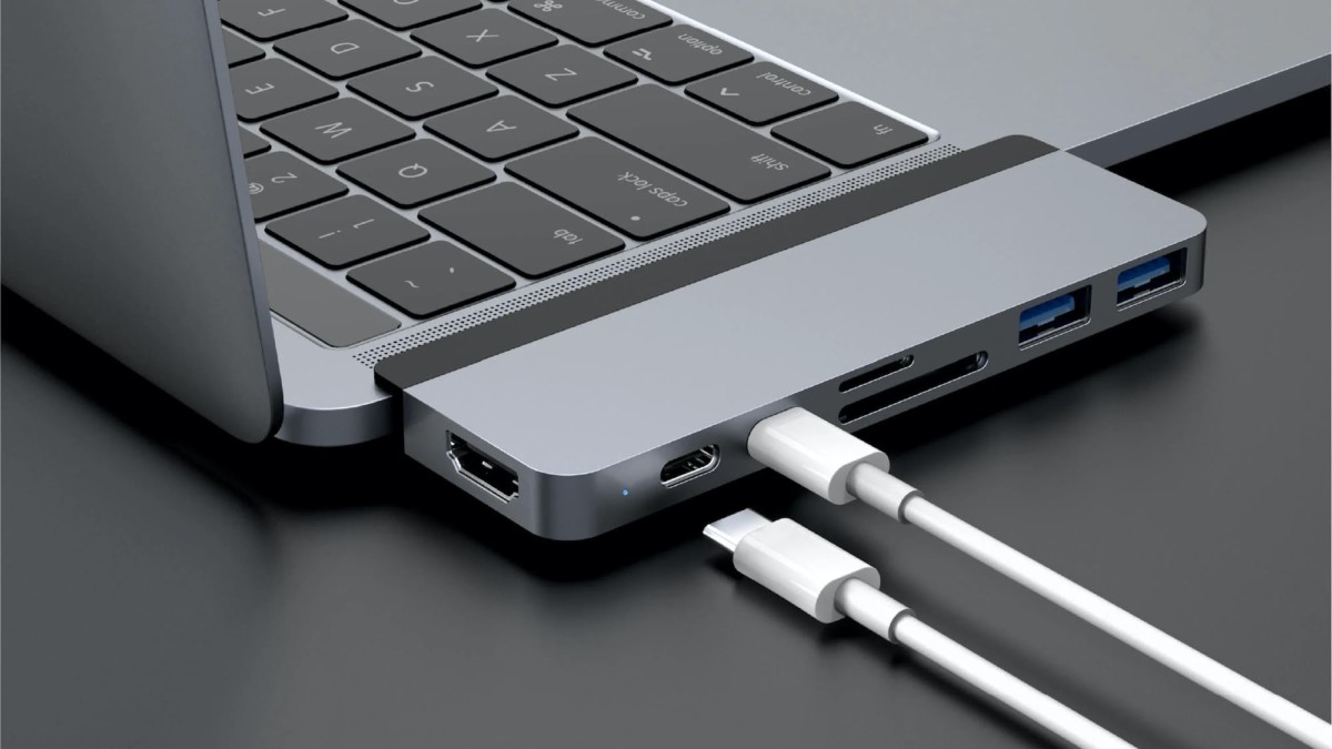 HYPER HyperDrive DUO MacBook USB-C Hub secures to your laptop with its magnetic grip