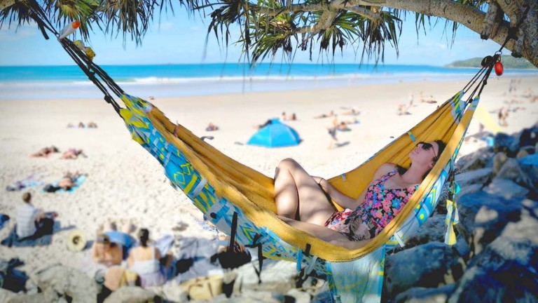 This travel accessory is a hammock, bag, & towel in one