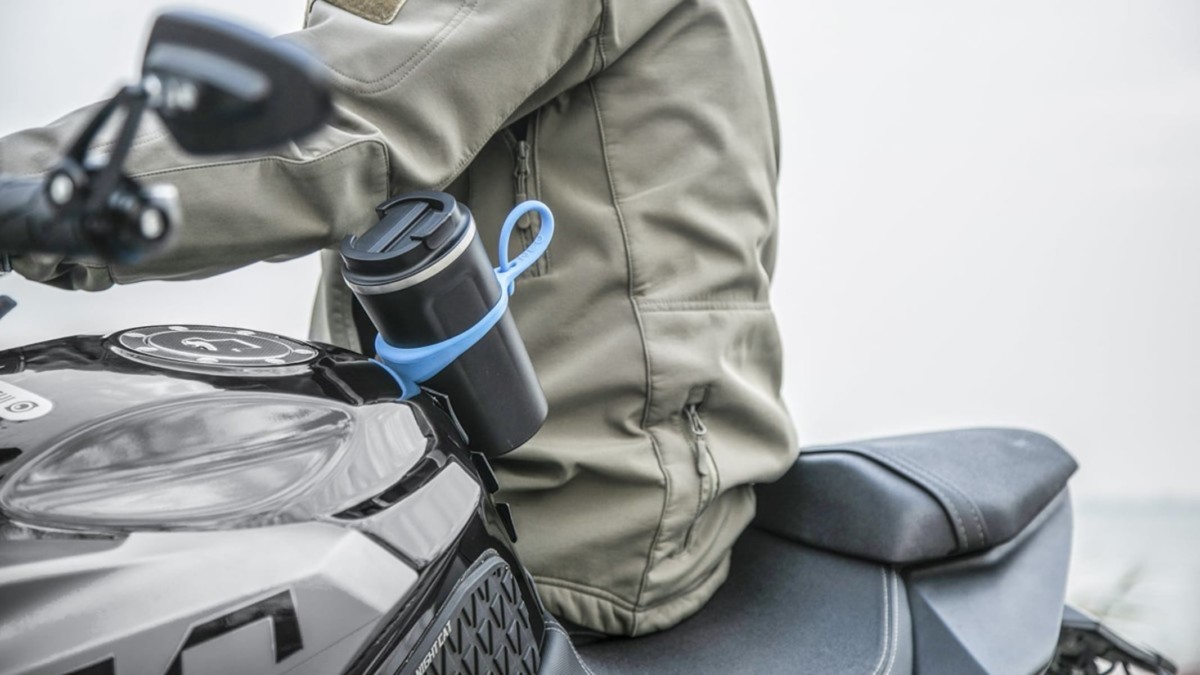 This magnetic bottle holder strap keeps your water bottle off the ground
