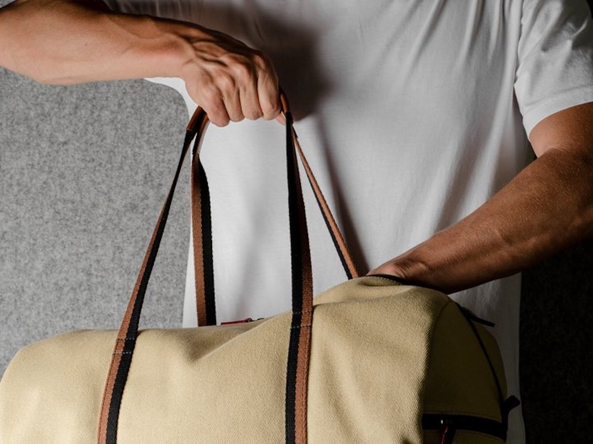 This barrel bag gym luggage provides storage for your clothes