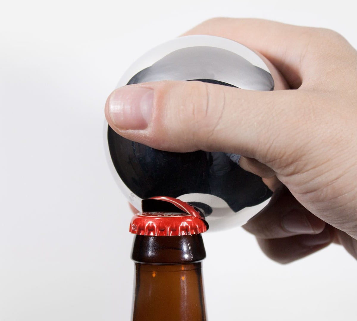Convex bottle opener has an elegant design borrowed from heavy industry