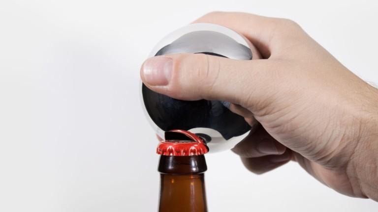 Convex bottle opener has an elegant design borrowed from heavy industry