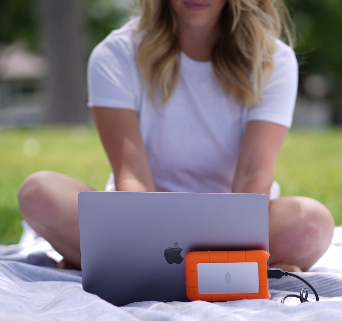 This laptop attachment securely holds hard drives and hubs