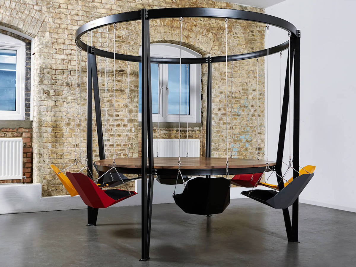 This King Arthur swinging table makes sitting more exciting