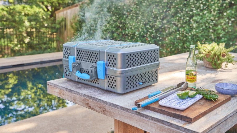 NOMAD Grill & Smoker portable charcoal barbecue is easy to carry anywhere