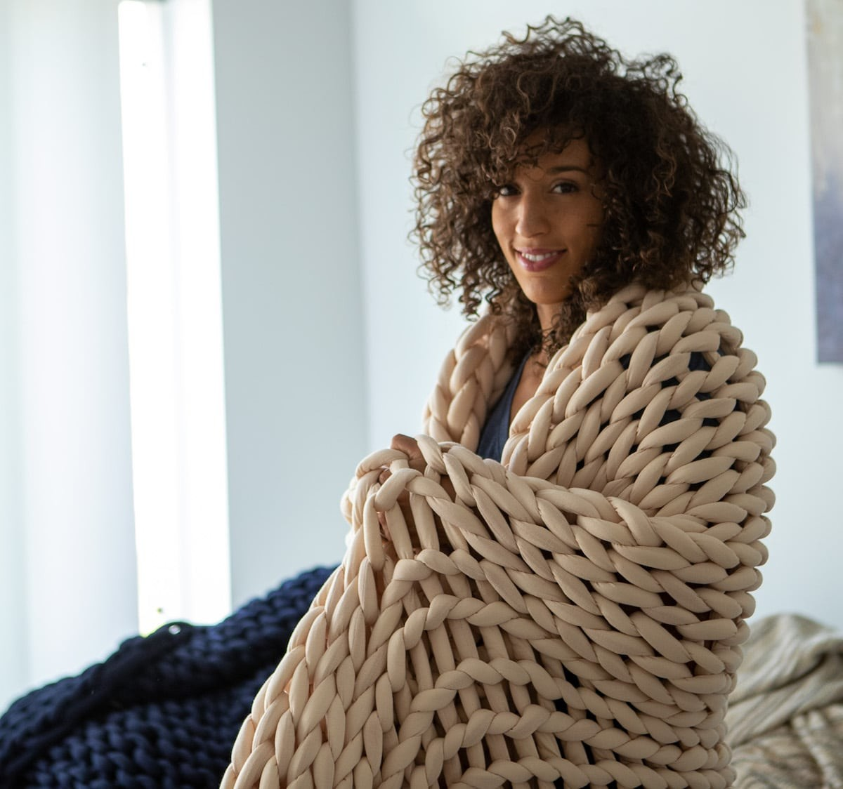 Nuzzie Knit weighted blanket relieves stress while keeping you so cozy