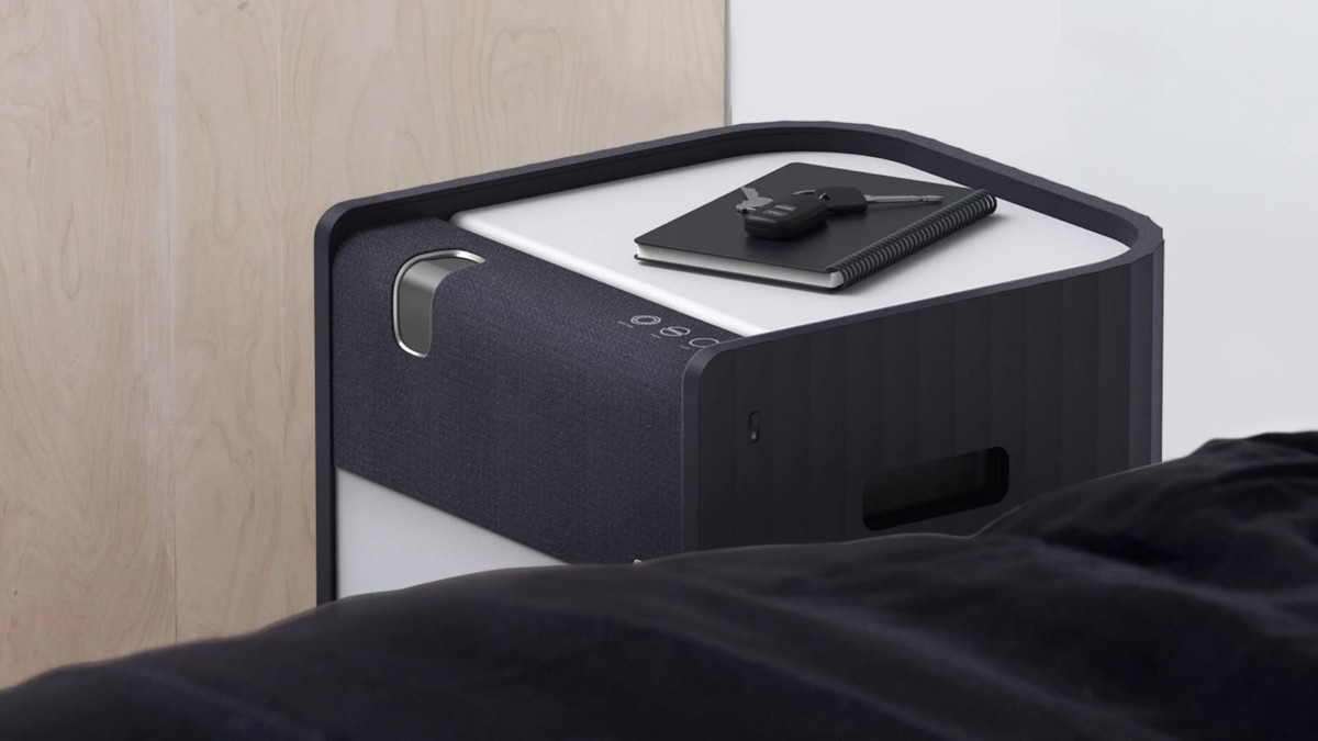Projectable side table projector also includes a smartphone wireless charger