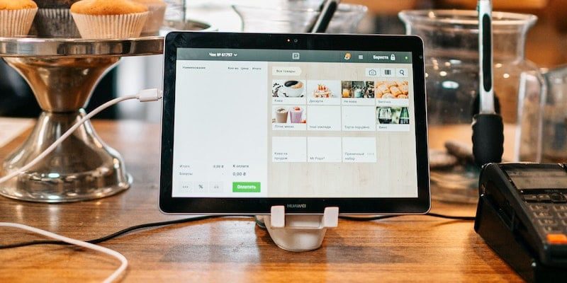 A tablet POS system on a stand at the counter in a bakery