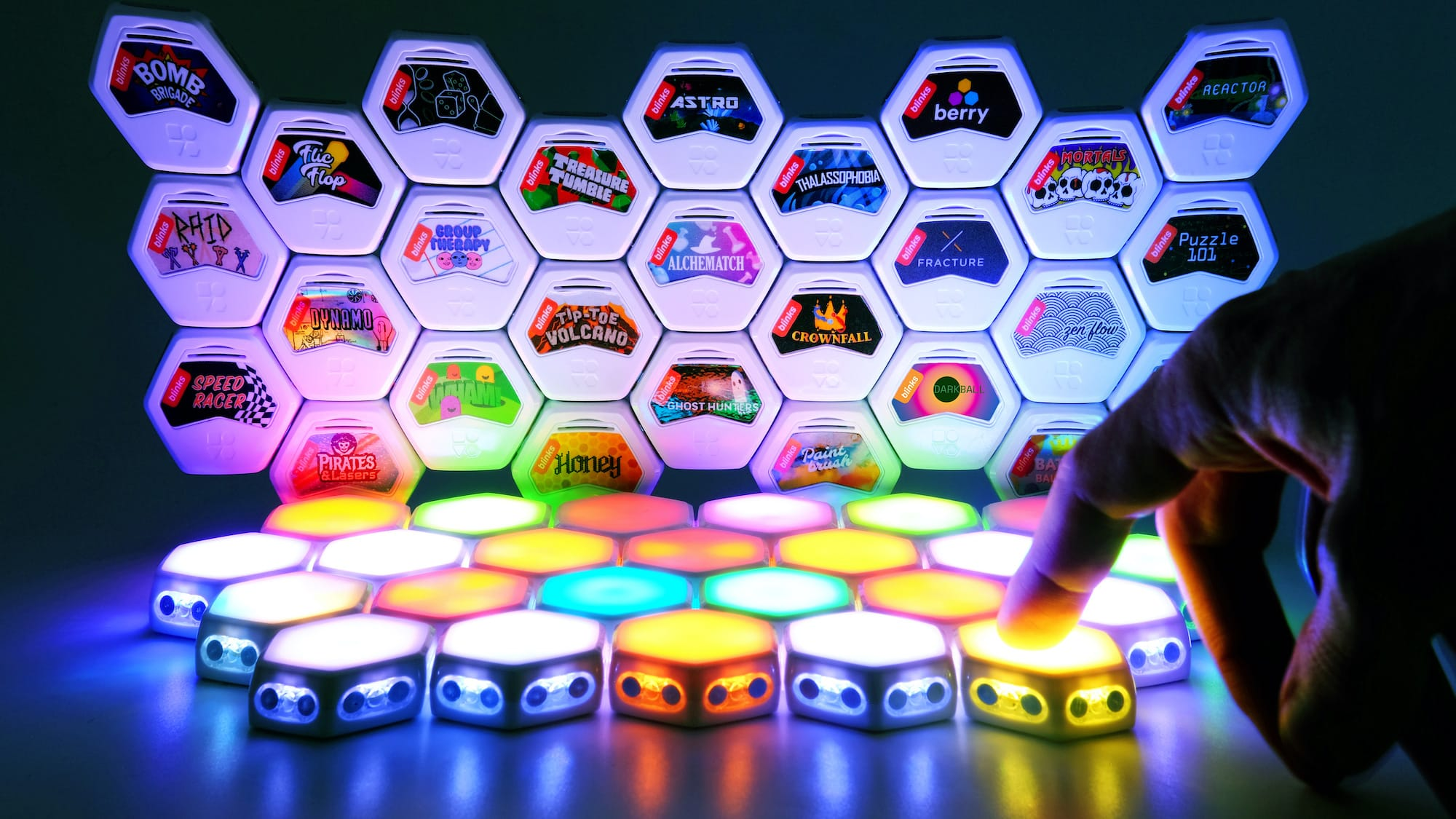Blinks by Move38 smart tabletop game system has futuristic, touch-sensitive game pieces