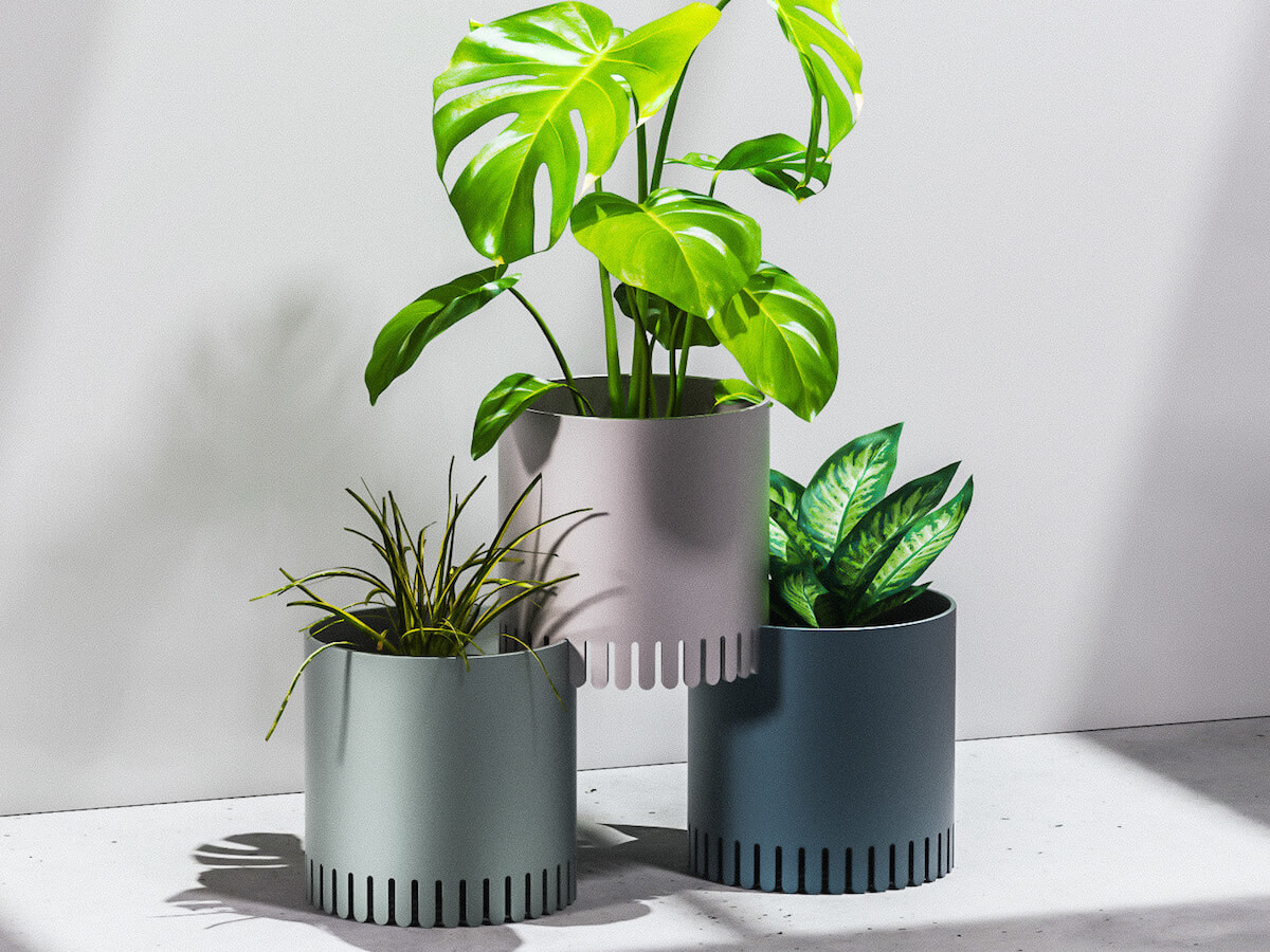 Chris Ference Elevated & Stackable Planters have toothed bases to connect together