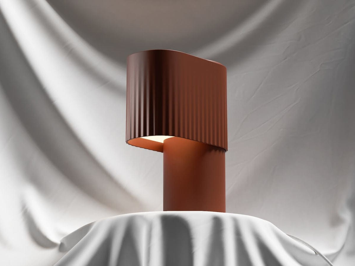 Gantri Encore Table Light warmly glowing lamp looks like curtains in a theater