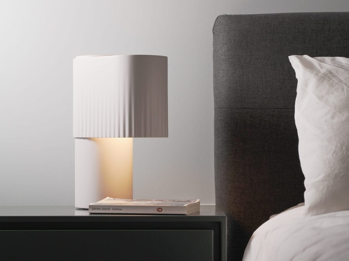 Gantri Encore Table Light warmly glowing lamp looks like curtains in a theater thumbnail