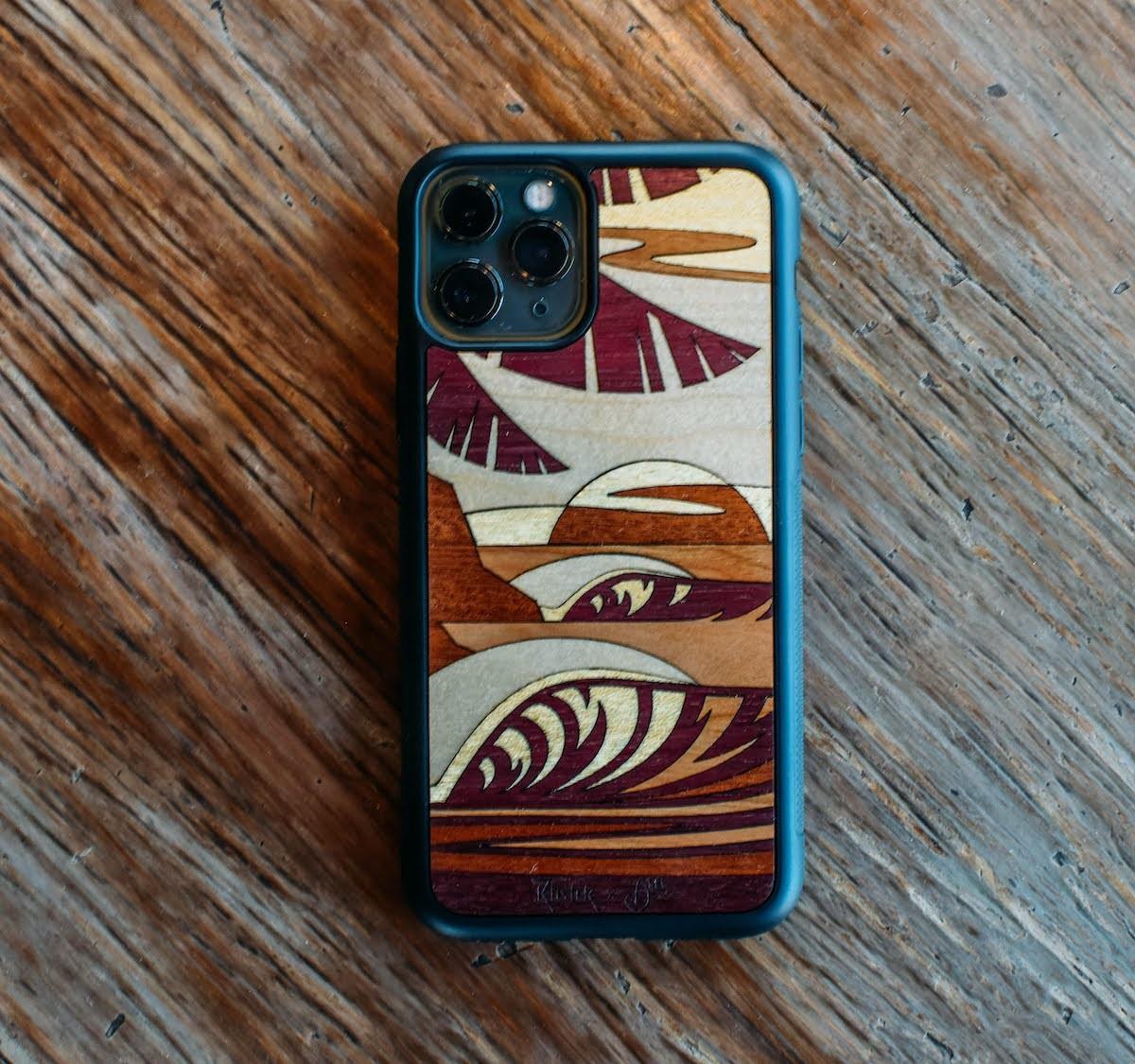 Rustek x Abel Arts Sun Sets West Inlay wood iPhone 12 case depicts a coastal landscape
