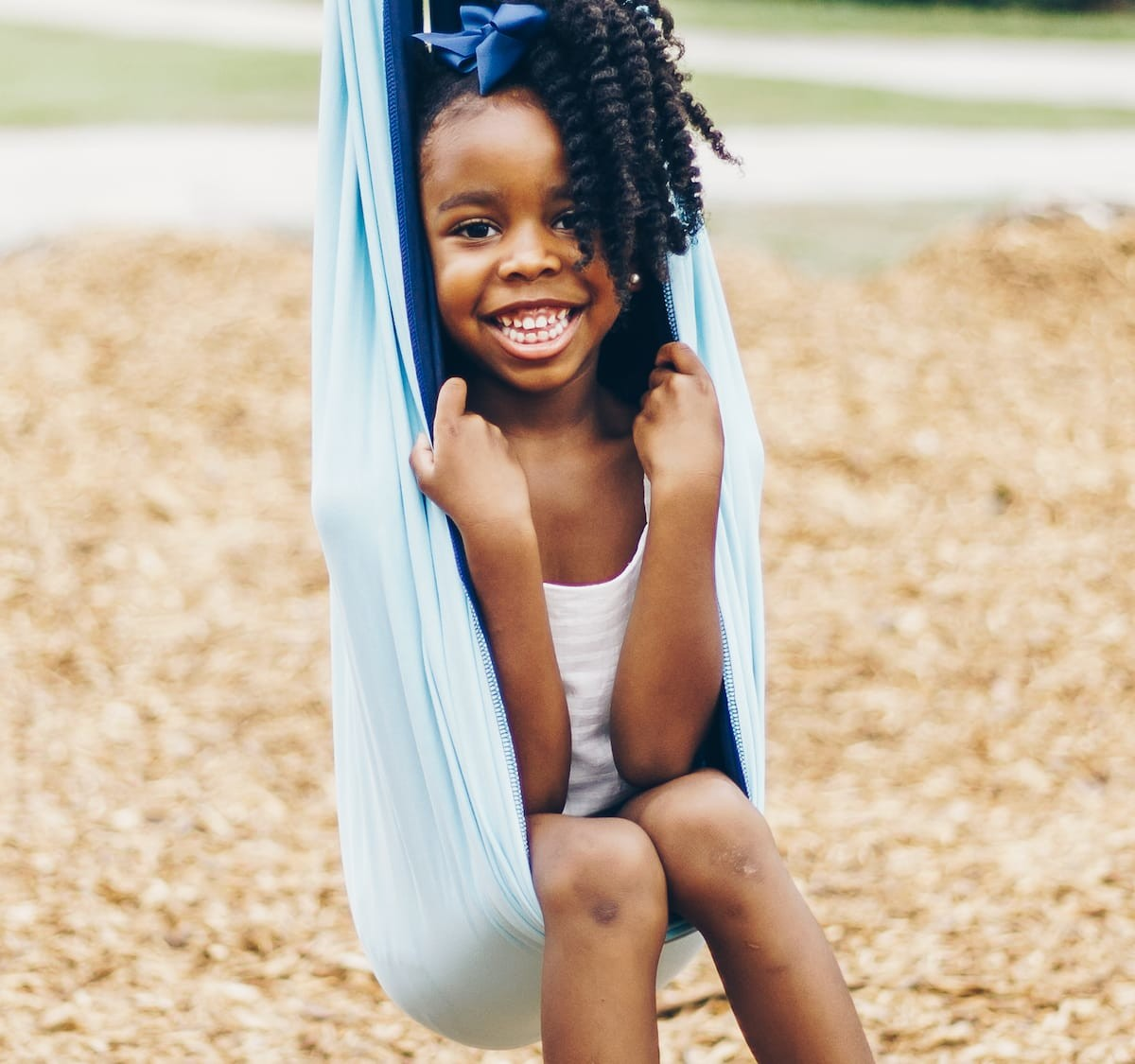Sensory Jungle Compression Swing offers a gentle hug for spatial and balance awareness