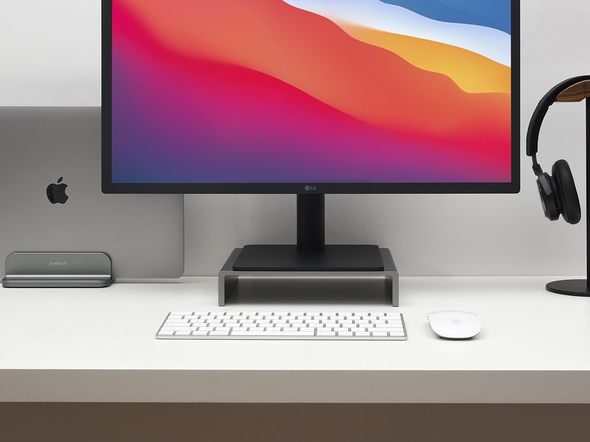 JOKItech Aluminum Vertical Laptop Stand keeps your workspace clear and organized