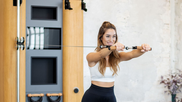 NOHrD Wall Compact all-in-one exercise wall features free weights and a virtual coach