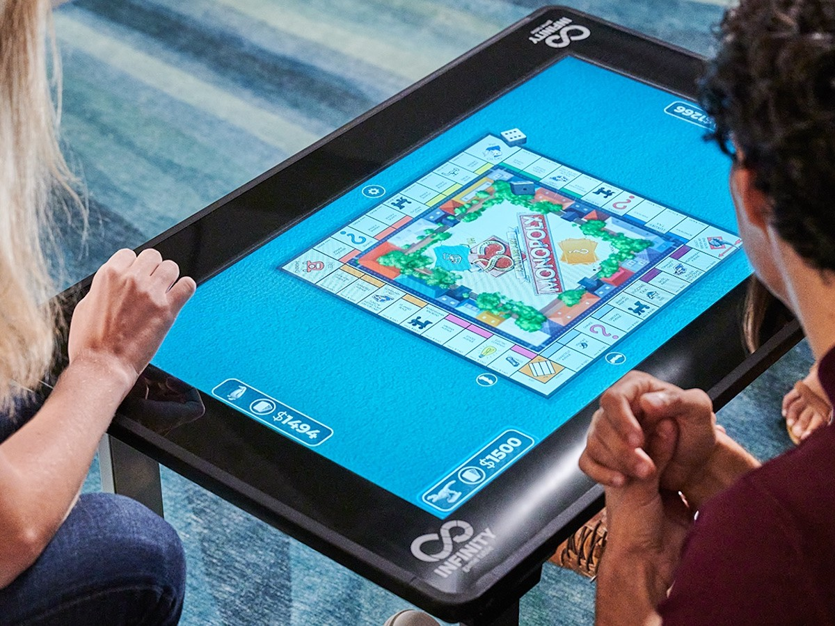 Arcade1Up Infinity Game Table features a high-resolution touchscreen