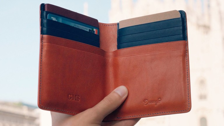 Danny P. Leather Passport Wallet has a passport slot, space for notes, & credit card slots