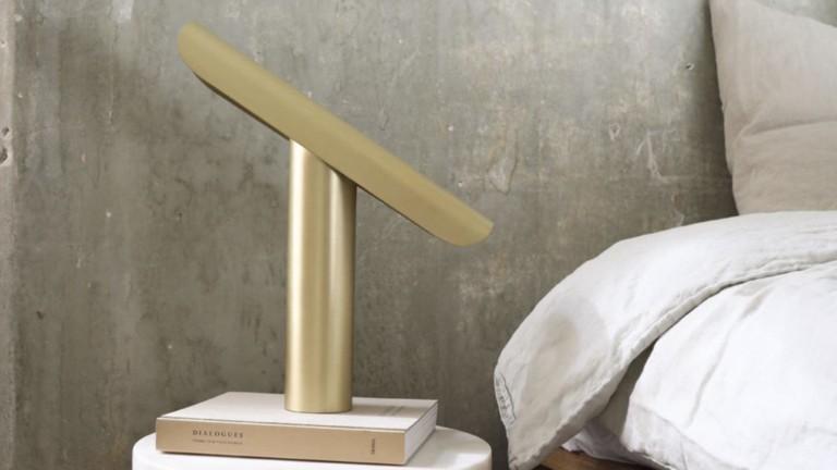 Frama T-Lamp archetypal desk light features a tiltable design