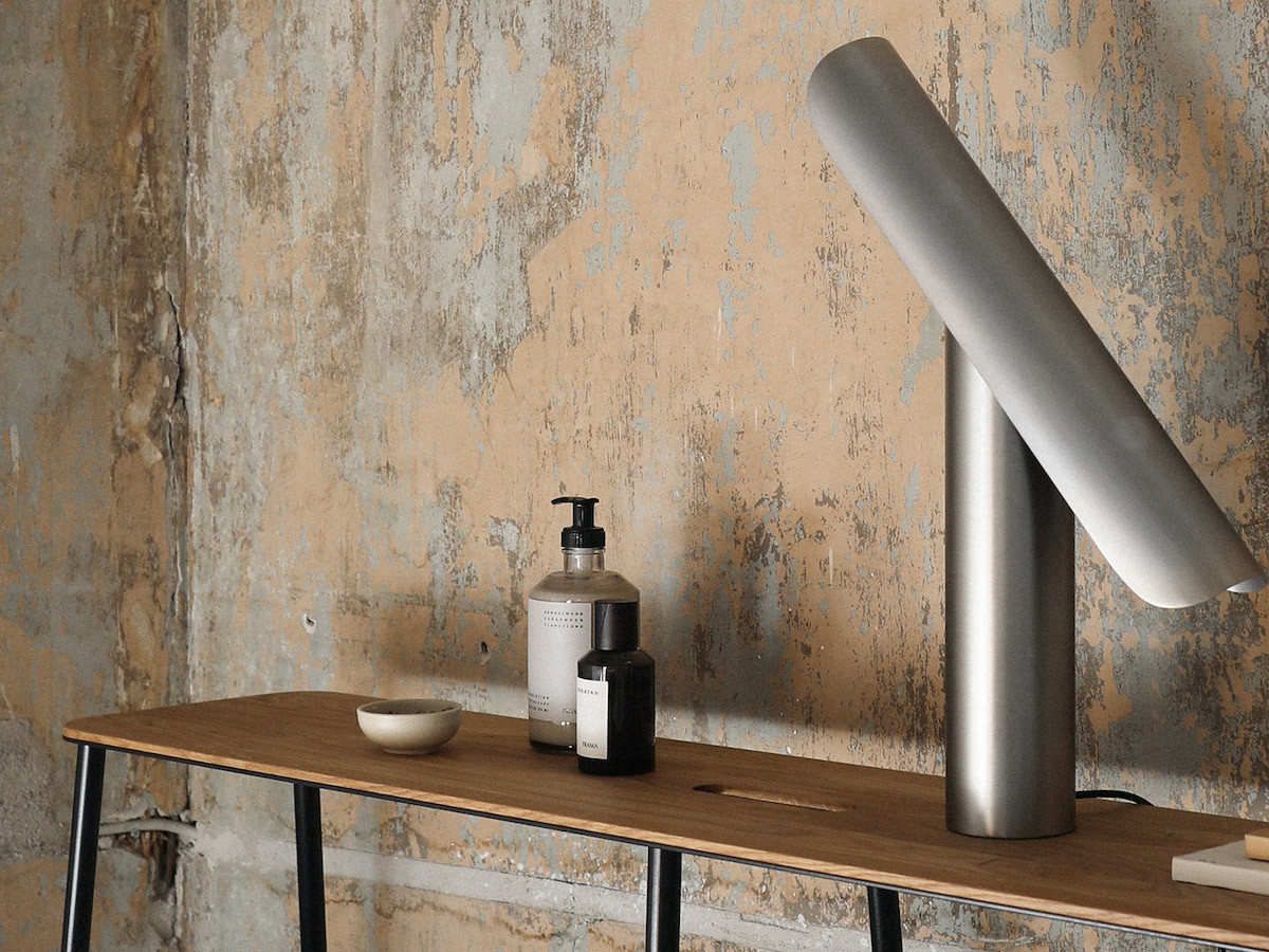 Frama T-Lamp archetypal desk light features a tiltable design