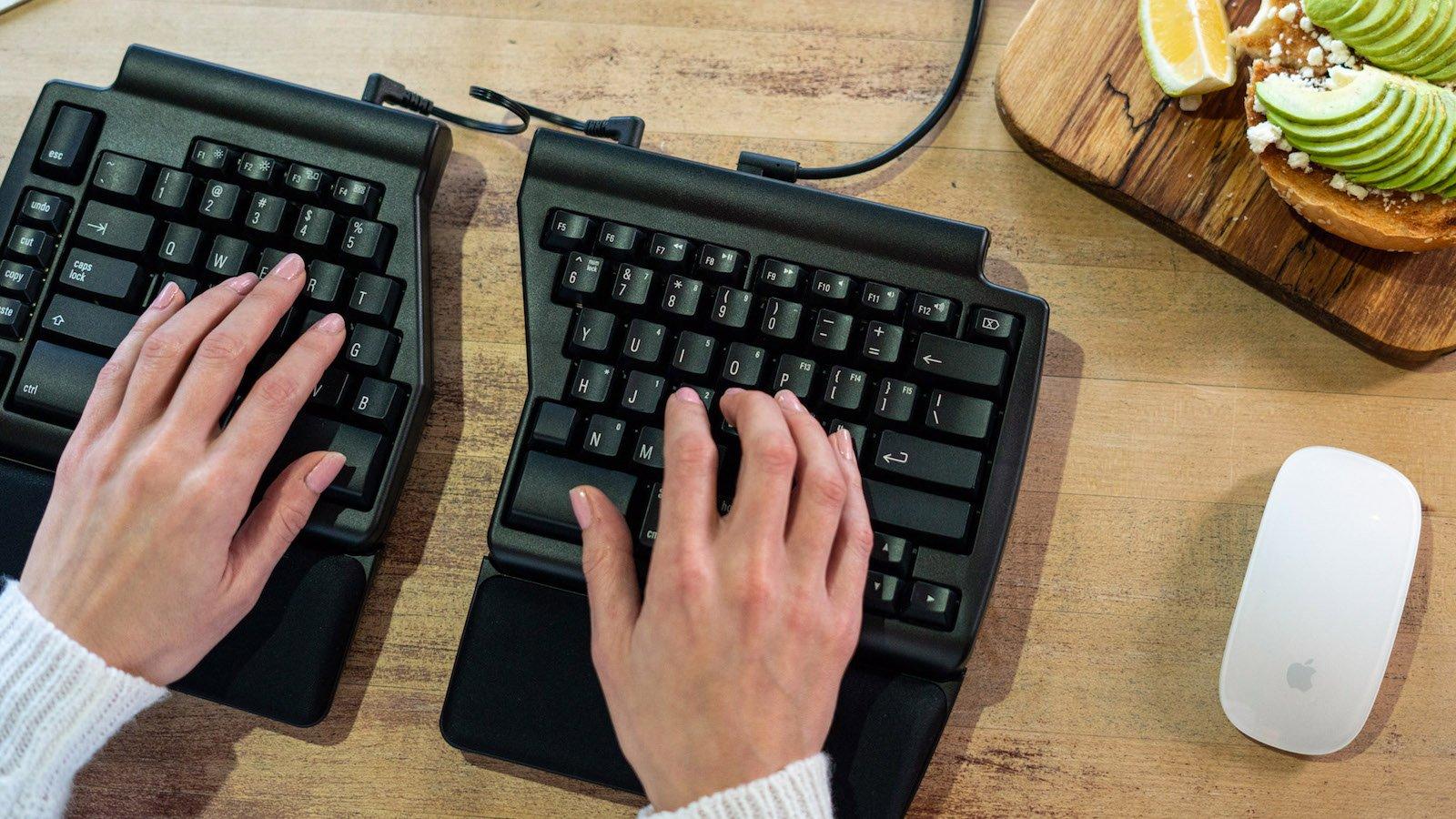Programmable Ergo Pro ergonomic mechanical keyboard provides a range of key adjustments