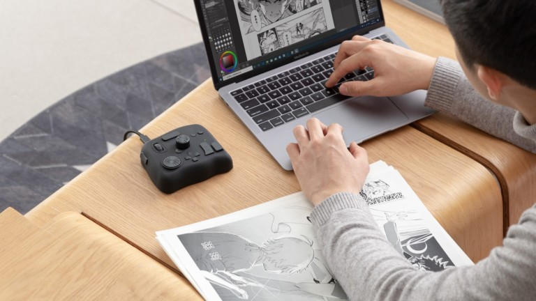 TourBox 2020 controller for creators naturally works with your mouse or graphics tablet