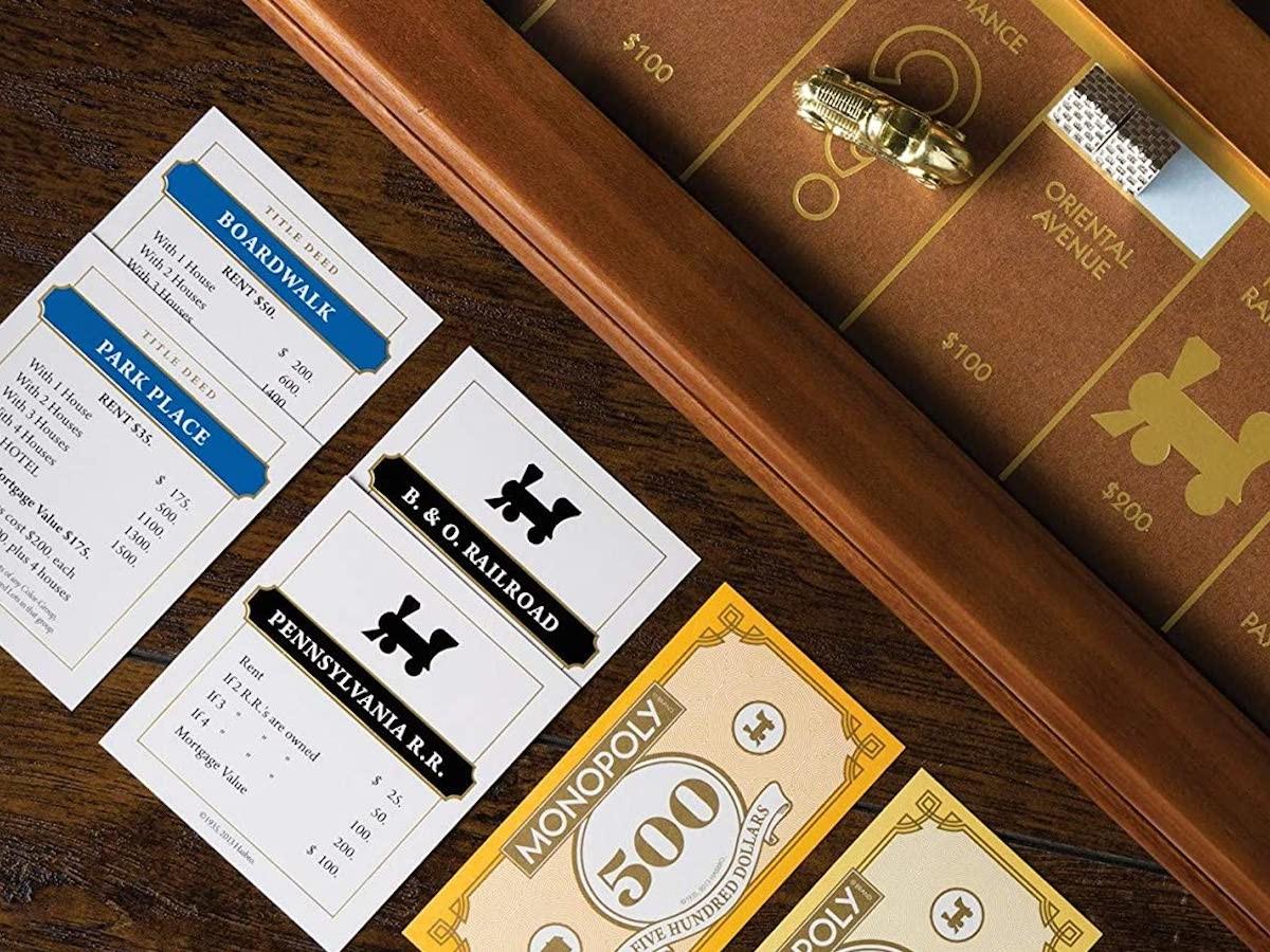 Winning Solutions Monopoly Luxury Edition board game has a faux-leather rolling area