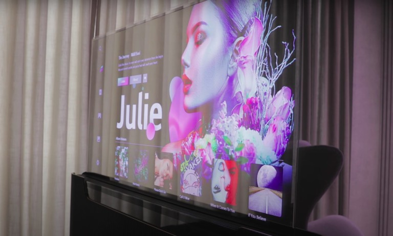 LG Transparent OLED TV rises from its casing to reveal the entire display