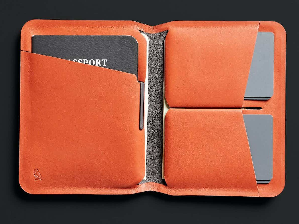 Bellroy Apex Leather Passport Cover holds your ID, 2 cards, bills, and included micro pen