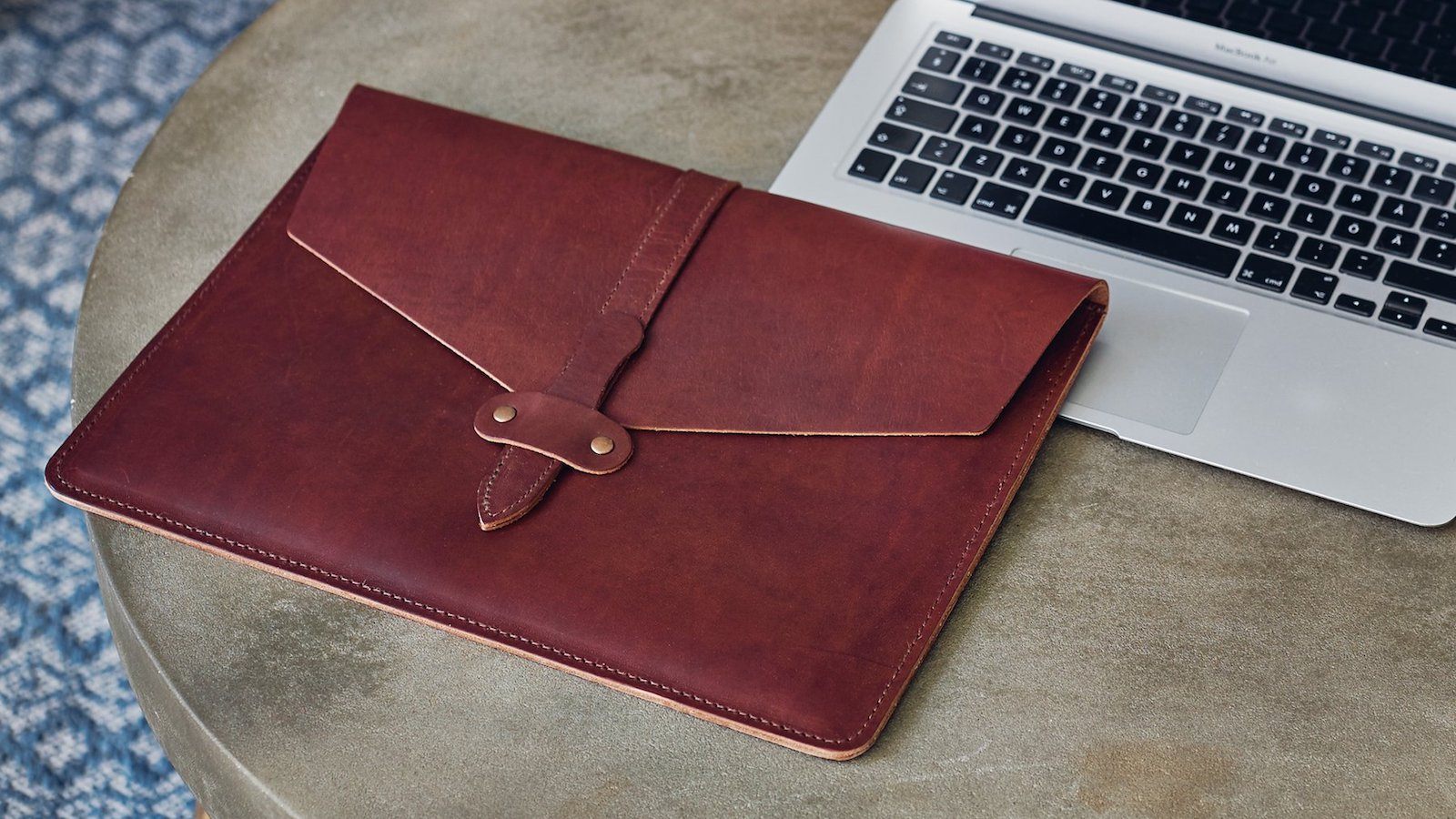 Kasperi Leather Secure Laptop Sleeve comfortably fits a laptop up to 13 inches
