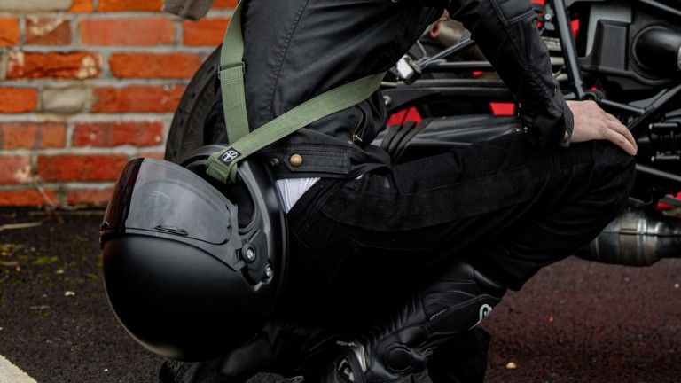 SLING helmet carry strap is made of wax cotton and great for everyone on two wheels
