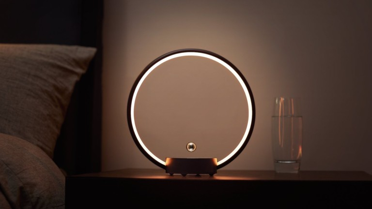 CIRCLO unique table lamp has a flying switch you touch to turn on and off