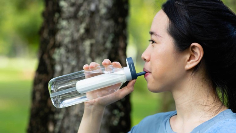 Lumistraw water-purifying bottle with a reusable straw gives you instantly clean water