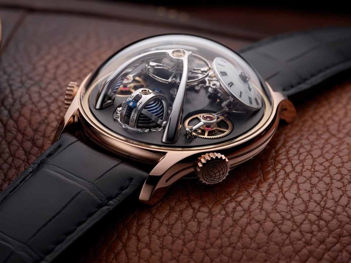 MB&F LMX luxury men's watch features a choice of 18k red gold or grade 5 titanium thumbnail