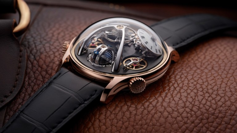 MB&F LMX luxury men's watch features a choice of 18k red gold or grade 5 titanium