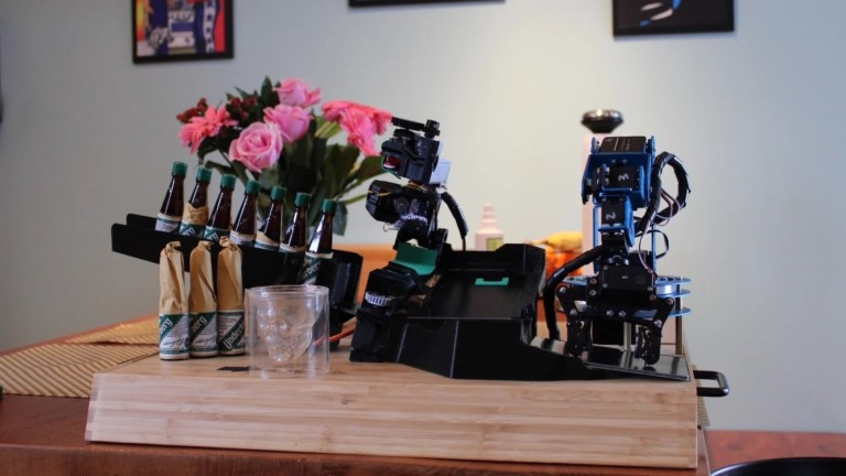 Mini Robotic Bartender automatically opens and pours a bottle of your choice
