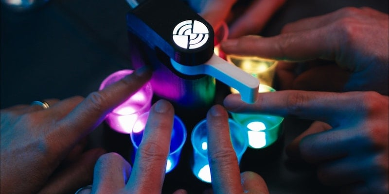 This cool party robot has 8 different drinking games RevoRoulette robot shot dispenser