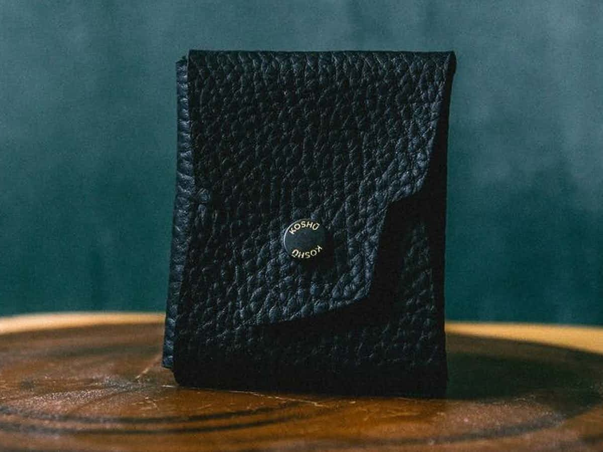 KOSHŪ Origami Leather Wallet provides a cash slide and a card pocket for a clean design