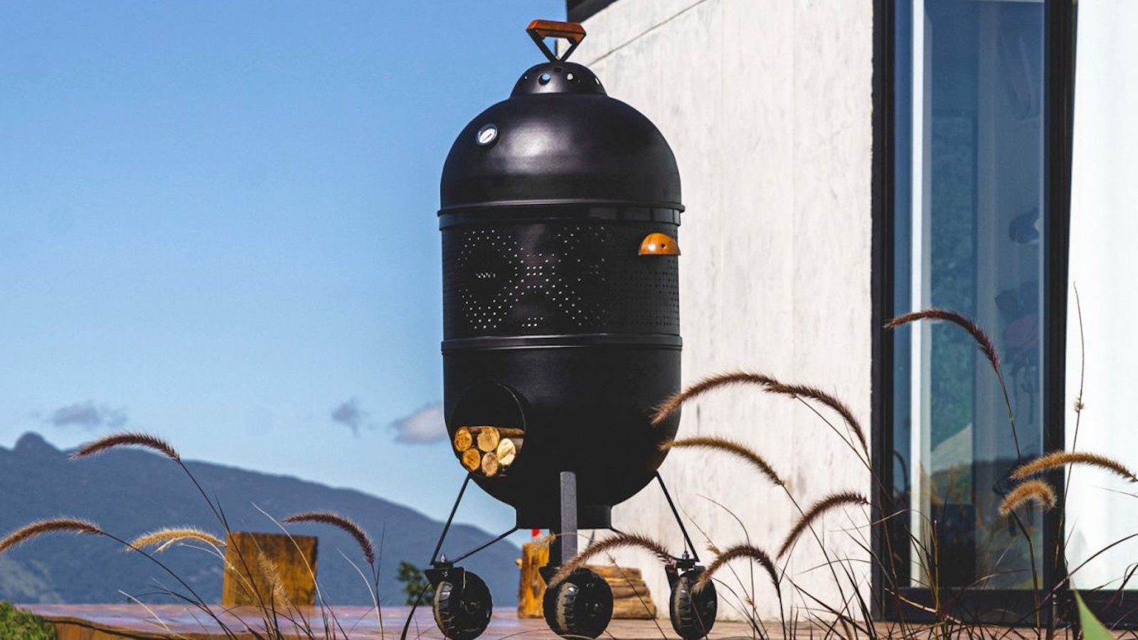 Noori V02 Airy woodburning stove has removable refractory plates that expose the flames