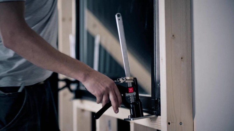 Viking Arm builder's tool assists you with installing doors, windows, and cabinets