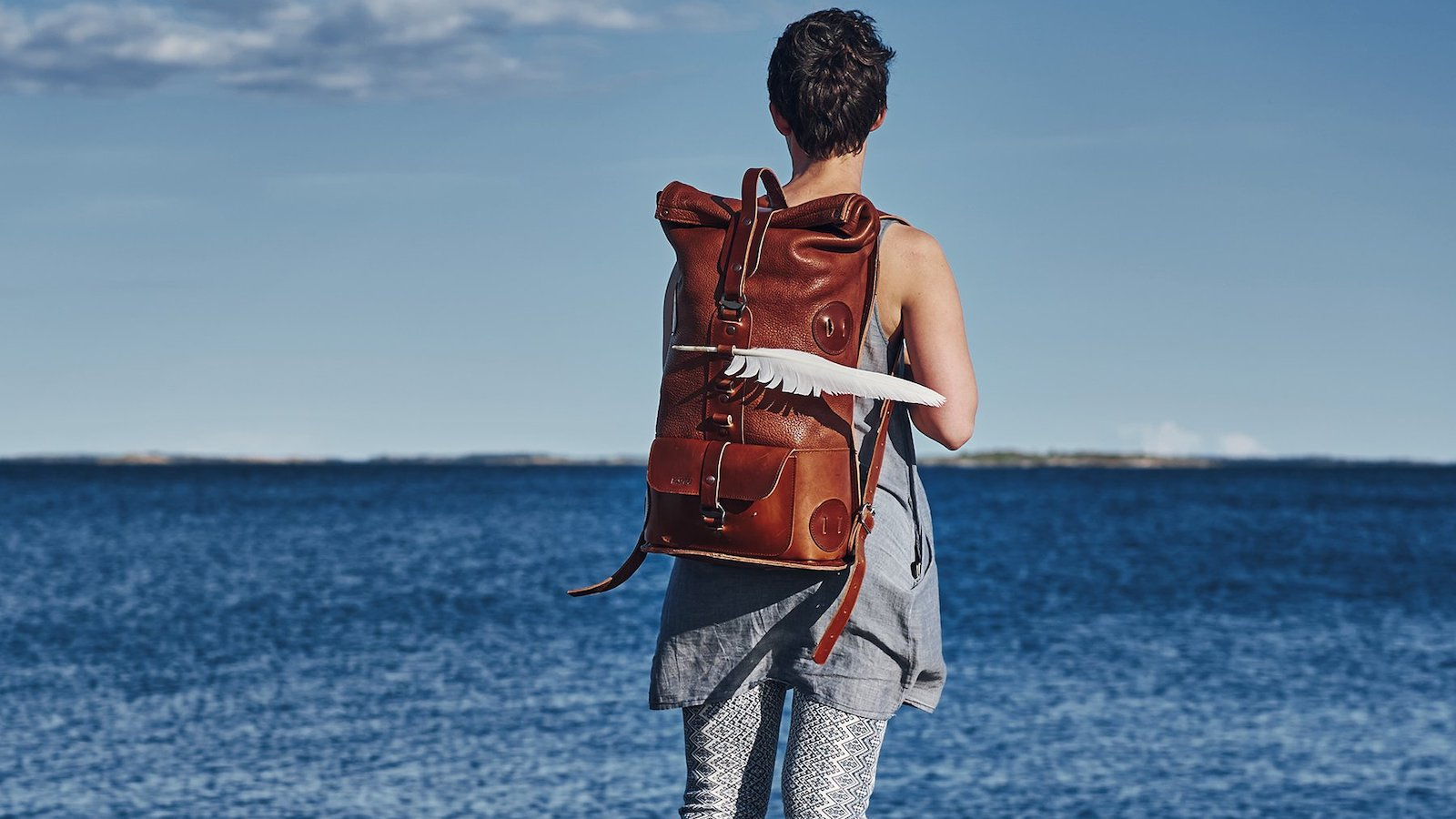 Kasperi Fold Top backpack features yak leather for a soft texture and rugged look