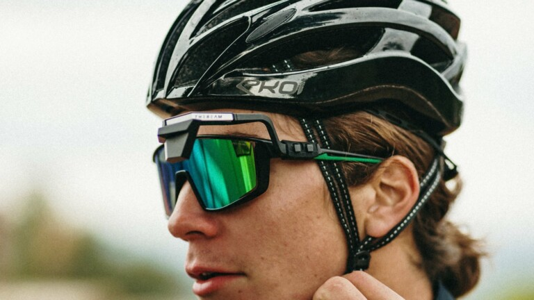 CORKY X sunglasses-mounted rearview mirror lets you see traffic behind you when cycling