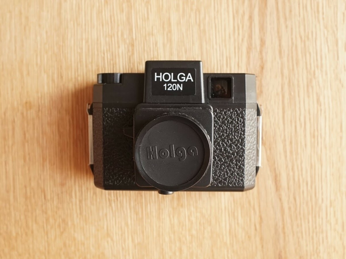 Holga 120N Plastic Camera has a built-in plastic lens with two different frame formats