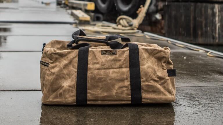 Huckberry Readywares Waxed Canvas Duffel Bag features high-quality 20 oz waxed canvas