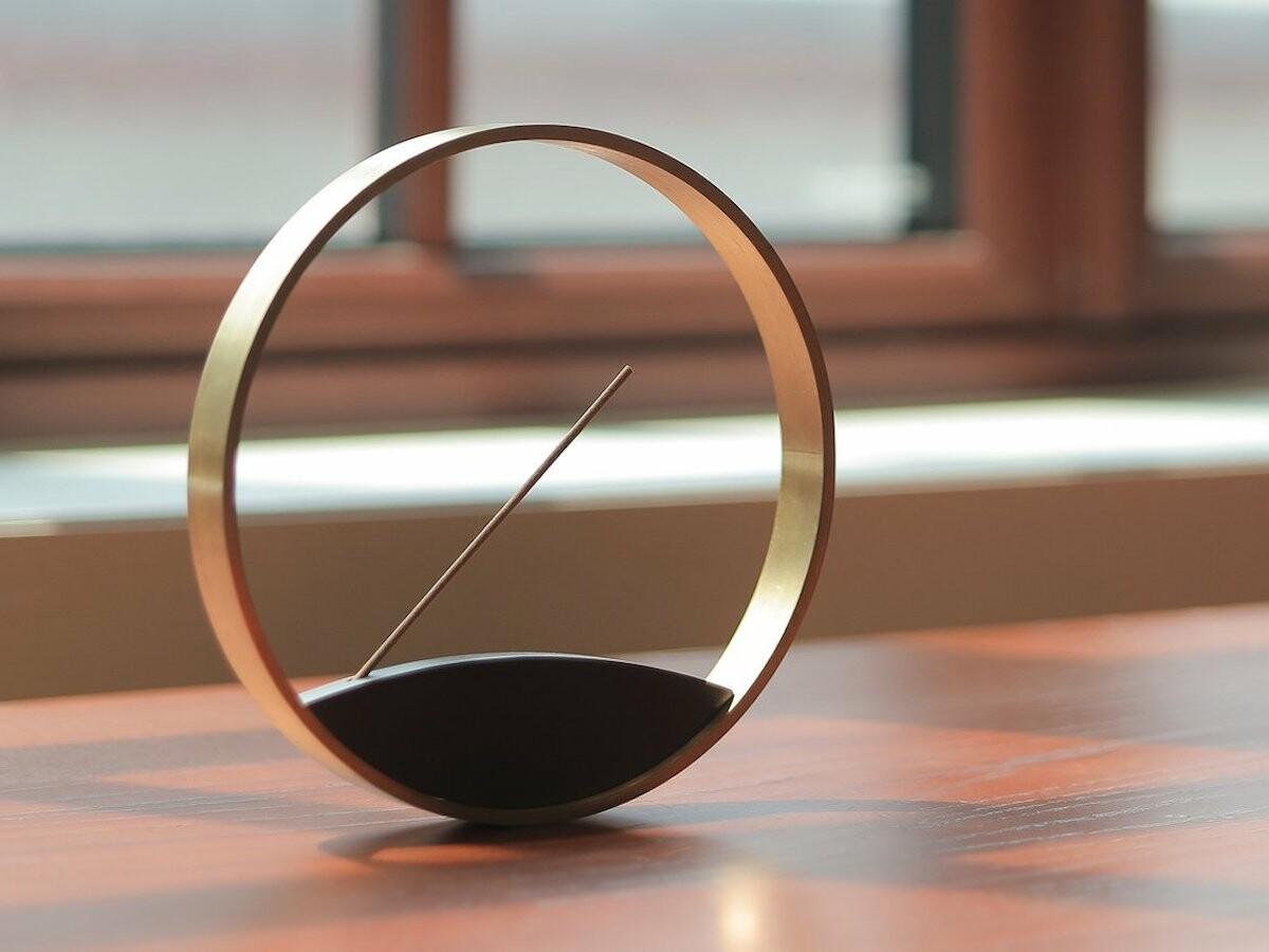 Kin Moon Horizon Incense Burner features a self balancing bronze ring, evoking simplicity