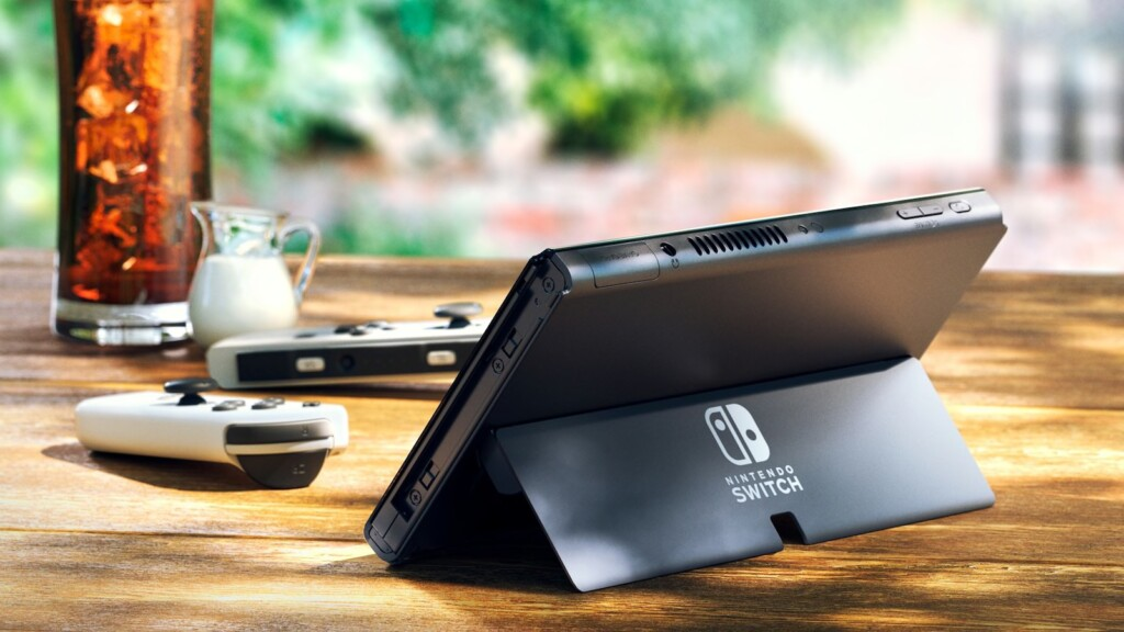 The Nintendo Switch OLED has a larger screen, increased storage, and LAN