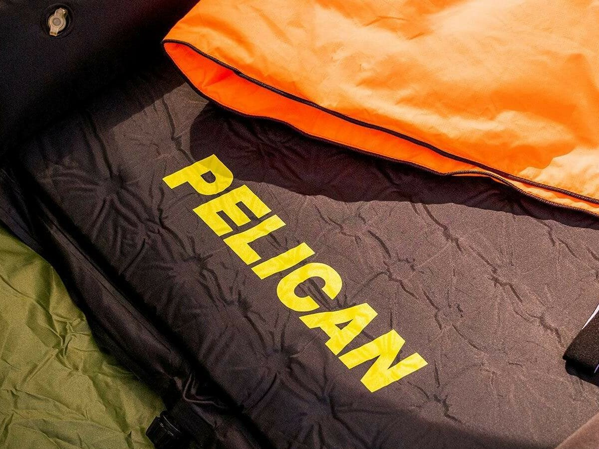 Pelican Outdoor Rugged Sleep Pad self-inflates to keep you comfortable while camping