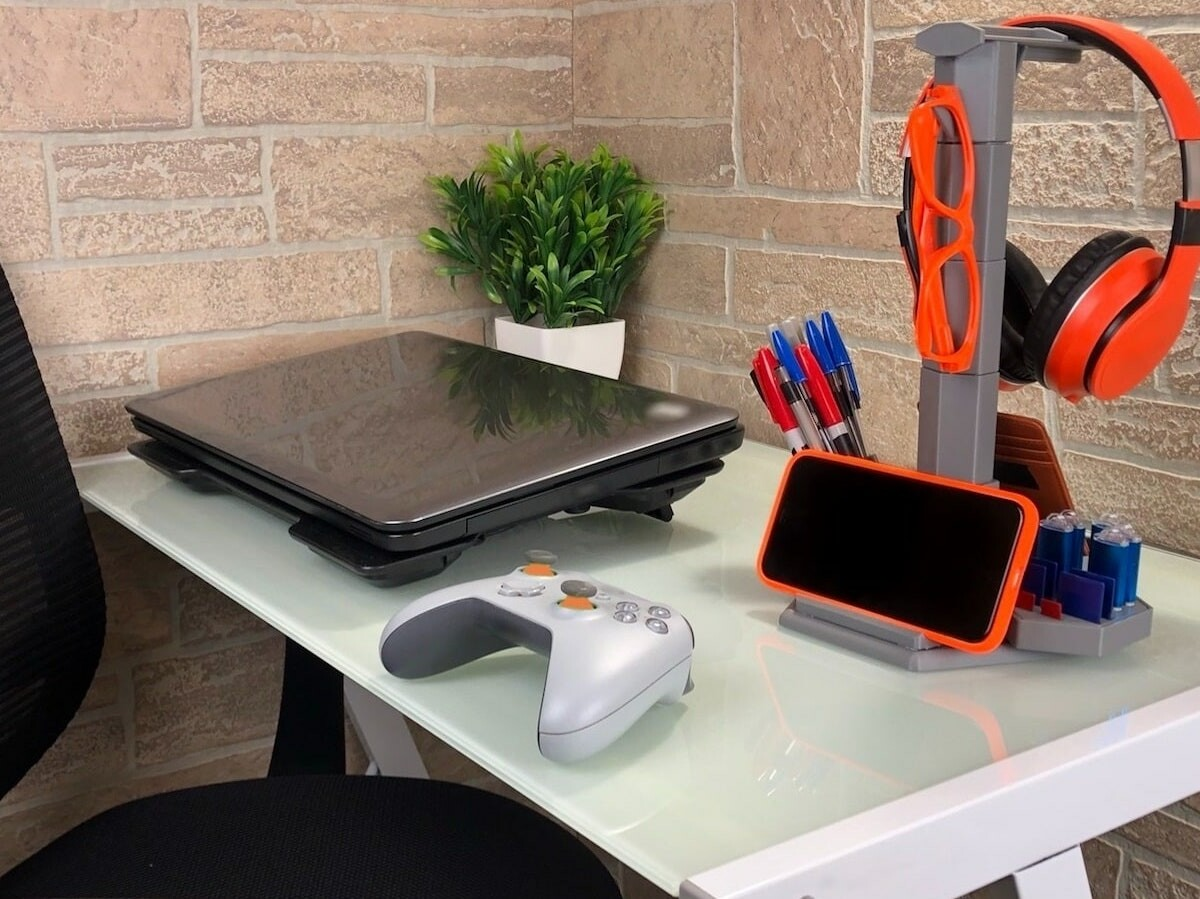 The Cyber Stand desk modular organizer holds 25+ items such as phones, wallet, pens, etc.