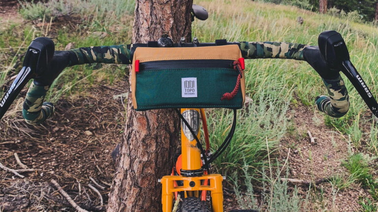 Topo Designs Mini Bike Bag has a water-resistant zipper and a truck tarp inner liner